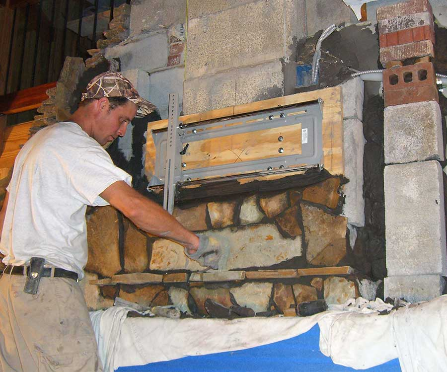 Technician Laying Brick For Building A Masonry Chimney